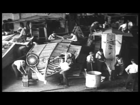 Men working on parts of a ship in a ship building factory in the United States. HD Stock Footage