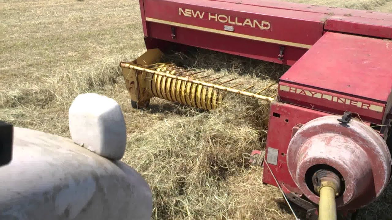 Baling with a ford 4000 and new Holland 378