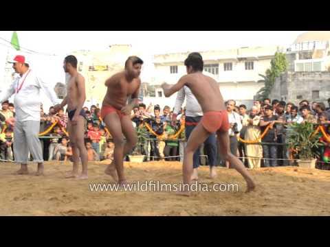 Indian tradition of boys mud wrestling at major festivals