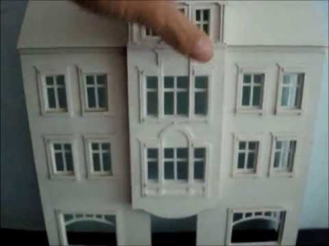 Papercraft Paper model.Residential building with shops.