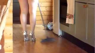Walking in silver high heels and mini skirt