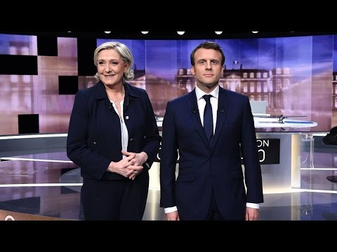 French Voters Face Presidential Election Between Xenophobic Candidate & Centrist Investment Banker