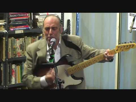 Mick Jones sings Should I stay or should I go? at the Rock and Roll Public Library