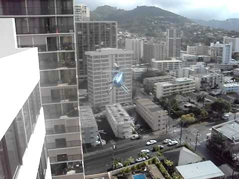 Helicopter between two high rise condo buildings in Makiki area of Honolulu Hawaii,