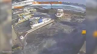 Departing cruise ship creates tsunami that destroys docks, boats
