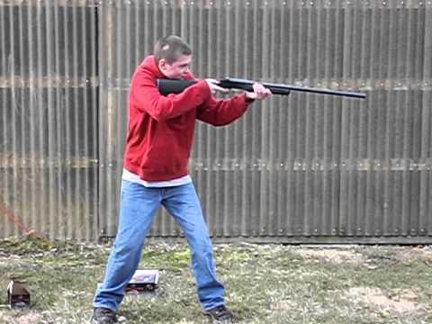 Nungi shooting a 12 gauge