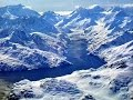Flying over Alaska in helicopter. Snowy Mountain Aerials - 1080p