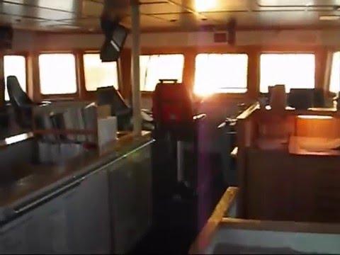 Platform Supply Ship Discharging Cargo at Oil Rig