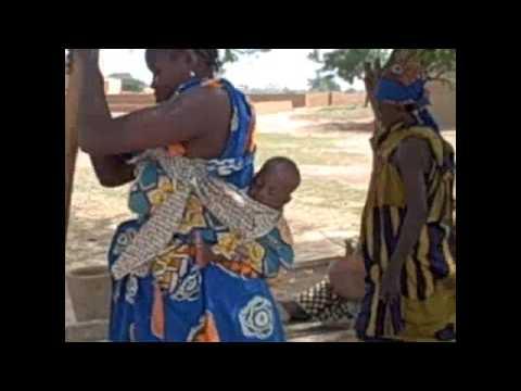 African Baby sleeping on Mom's back