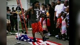 Lil' Wayne steps on flag and into trouble