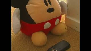 Mickey Mouse finds a mobile.