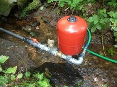 Hydraulic ram pump pressure tanks
