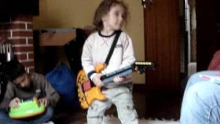 Ari playing guitar