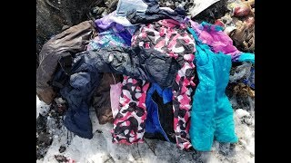 Burning pile of old winter gear / snow pants & coats & jackets