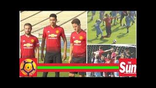 Manchester United stars Juan Mata, Ander Herrera and Chris Smalling take on 100 kids in brilliant s