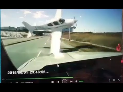 CAUGHT ON CAMERA: Dash-cam captures car's  near miss with plane