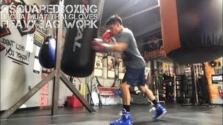 Hitting the Heavy Bag With Decha Muay Thai Boxing Gloves