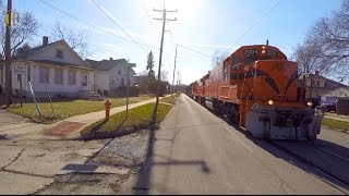 Train Running Down Middle of Street
