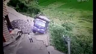 A Guy jumps for his life when a Dumptruck tips over