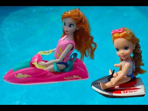 Elsa and Anna toddlers fun in the swimming pool