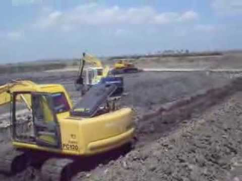 Pond construction in a commercial fish farm with a harvest for Pond construction for fish farming