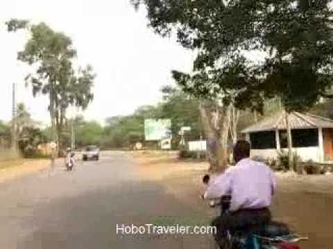 Motorcycle Taxi Running Stop Sign in Lome Togo Moto