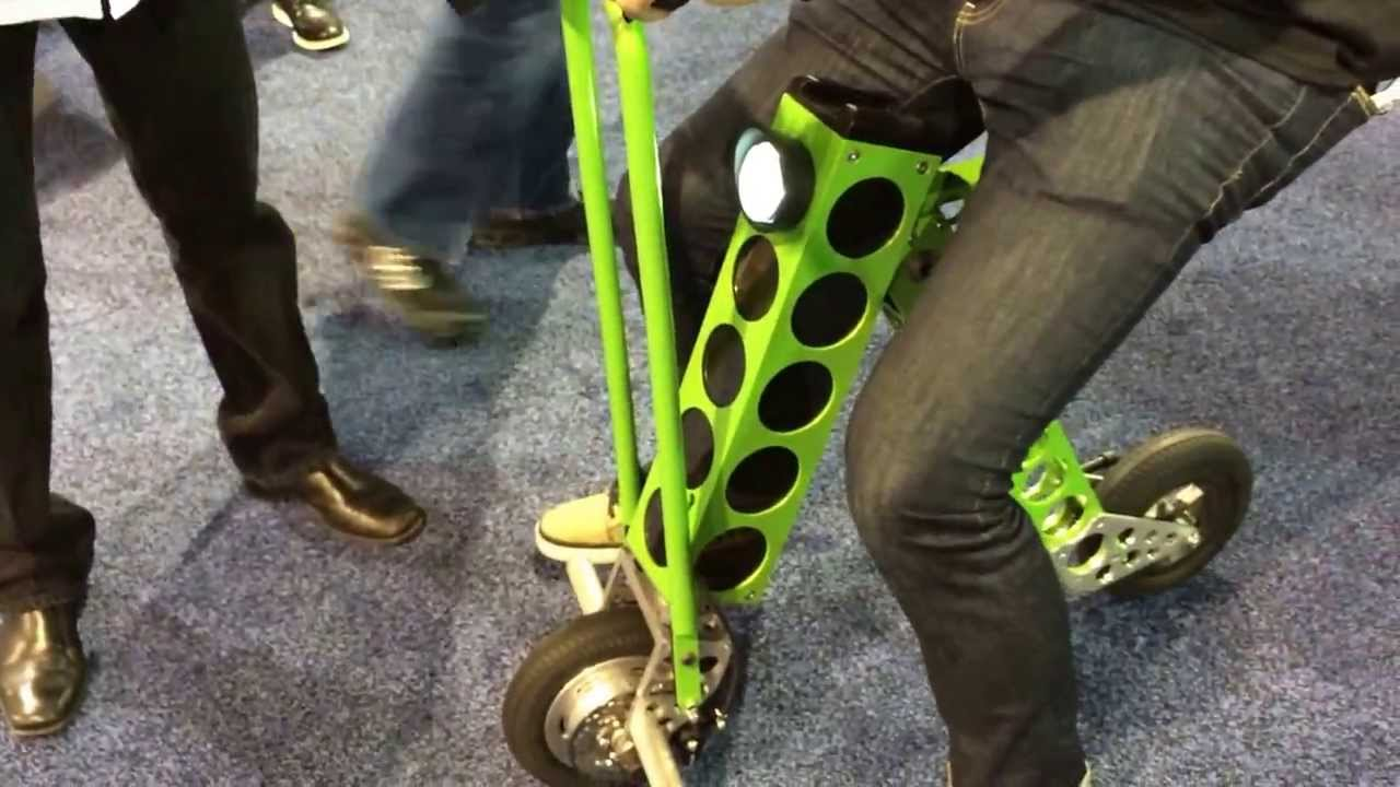 ces 2014 urb e le mini scooter lectrique pliable youtube. Black Bedroom Furniture Sets. Home Design Ideas