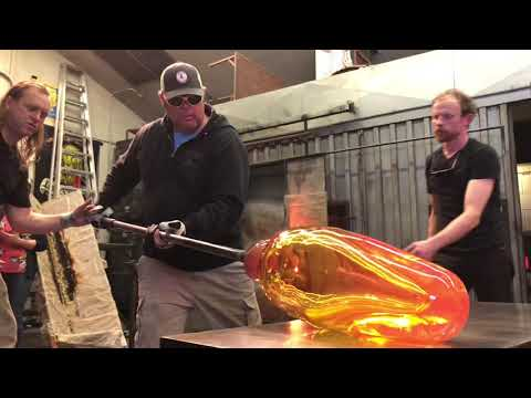 Glass artists Jerome Baker Designs create a tube for a very large bong