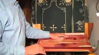 Watch the step by step assembly of an Adirondack Glider made from beautiful aromatic red cedar.