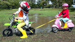 Max and Katy stuck in mud on the motorbike
