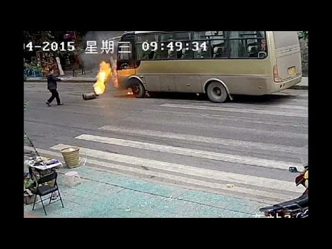 Rolling gas cylinder causes bus fire in southwest China - no comment