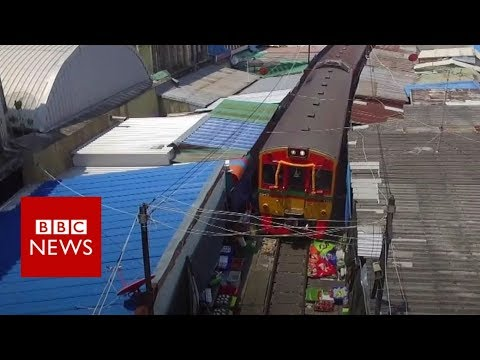 Αποτέλεσμα εικόνας για train that drives through a market - BBC News