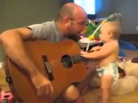 funny baby playing gitar