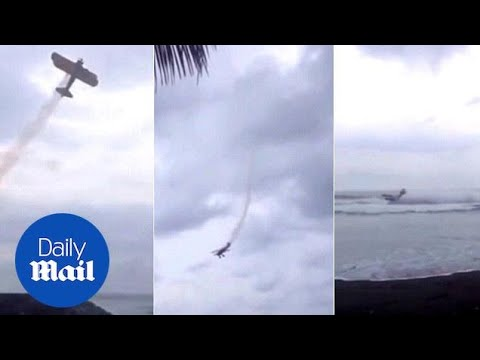 Stunt plane shocks onlookers as it crash lands into sea in Guatemala - Daily Mail