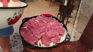 The favourite dish of Genghis Khan Temujin  The meat in the cauldron on the hearth  barbecue, B B Q