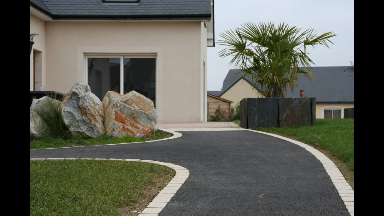Am nagement contemporain descente de garage cl ture bord for Amenagement exterieur de maison