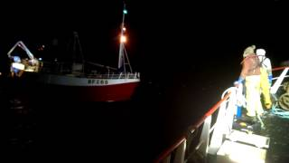 North sea trawlers help each other out
