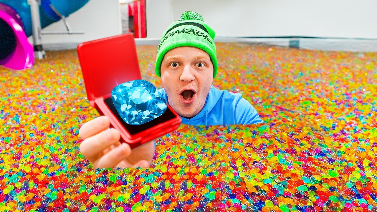 Hiding $100,000 DIAMOND In 50 MILLION ORBEEZ! - download from YouTube for free