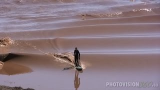 Surfer Rides Petitcodiac Tidal Bore, long version