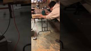 Cutting the bottom guide of a sliding barn door .