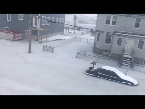 Cars freeze in floodwaters in Revere, Massachusetts