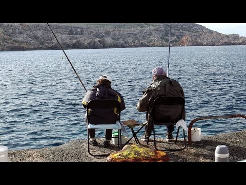 FISHING ON DOCK AT SIDE OF PARADISE BAY