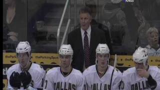 Marc Crawford checks out a fan behind the bench