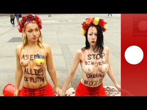 Topless against Putin: Femen activists protest in Italy ahead of Russia-Ukraine talks