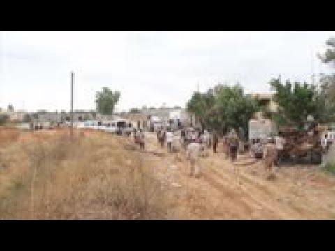 Libya govt forces battle Hifter forces near capital