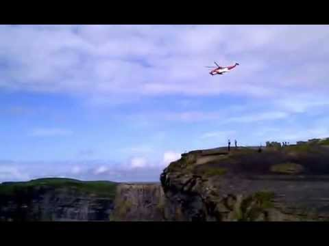 Irish coast guard helicopter at cliffs of moher