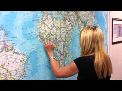 Lara looks for Brussels Belgium and Togo Africa on a World Map