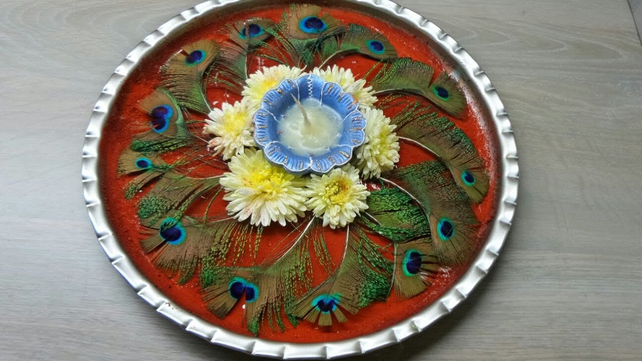 Pooja thali decoration peacock feather youtube for Aarti thali decoration with flowers