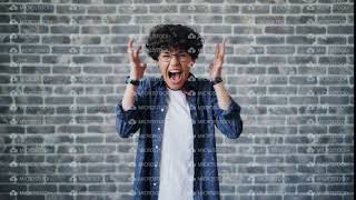 Portrait of angry young girl student screaming standing on brick background
