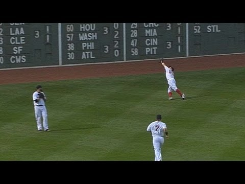 Holt dives to catch a ball Gomes cannot see